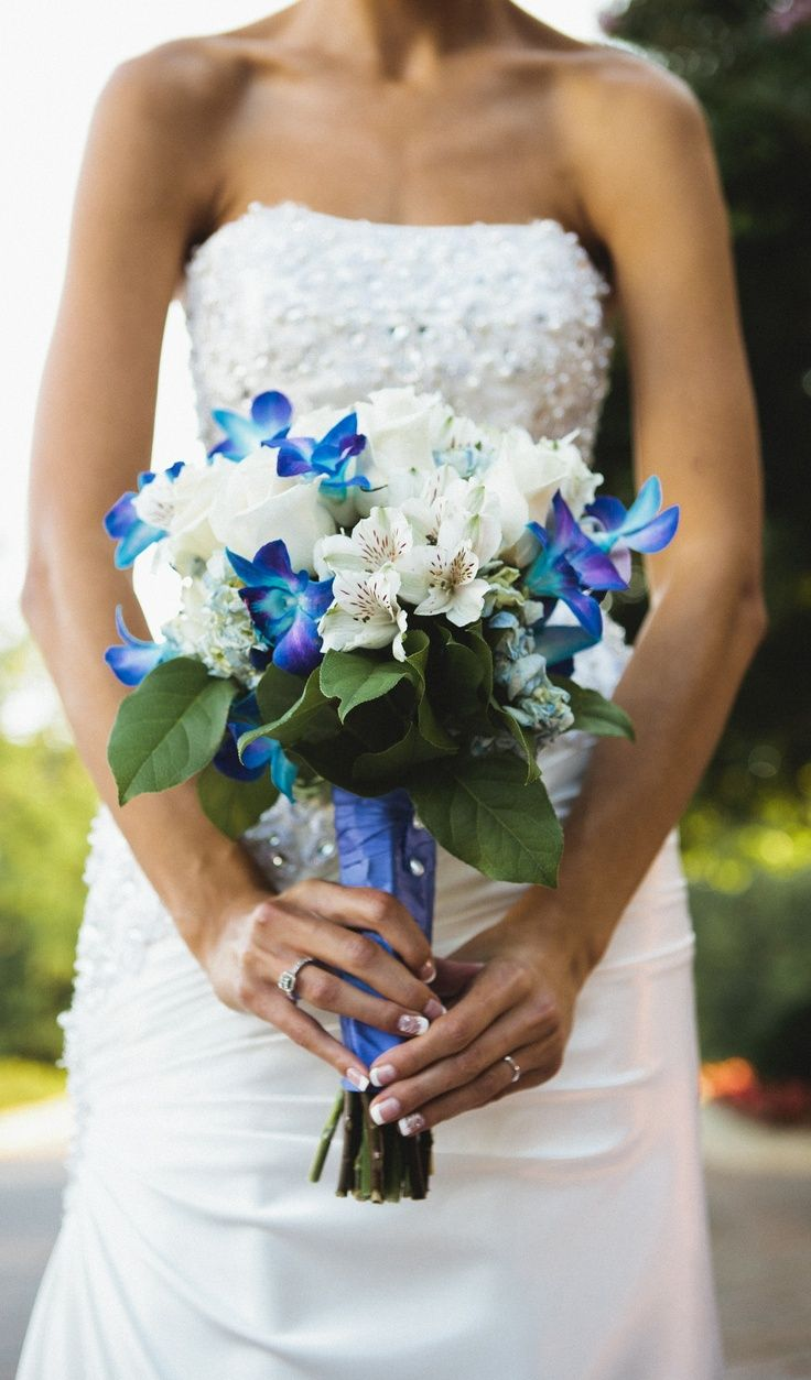White roses blue dendrobium orchids blue hydrangea and some small