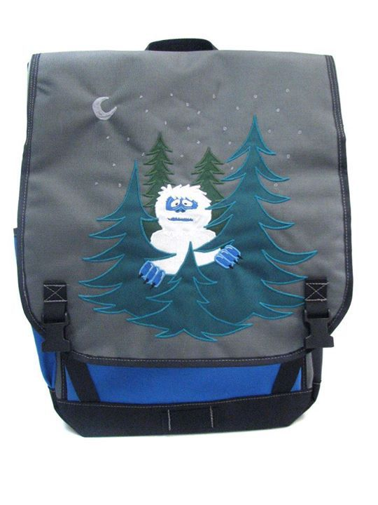 75b95672a4d1 Super fun waterproof flaptop backpack with a yeti graphic. Black Star