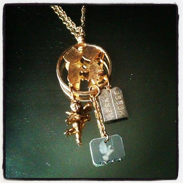 The Kiss Necklace with cherub charm, ten commandments pendant and Visa hologram