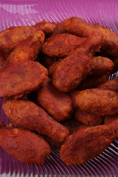 Vegan hot wings - spicy, saucy and with a little bit of sweetness. The texture closely mimics that of a chicken nugget.