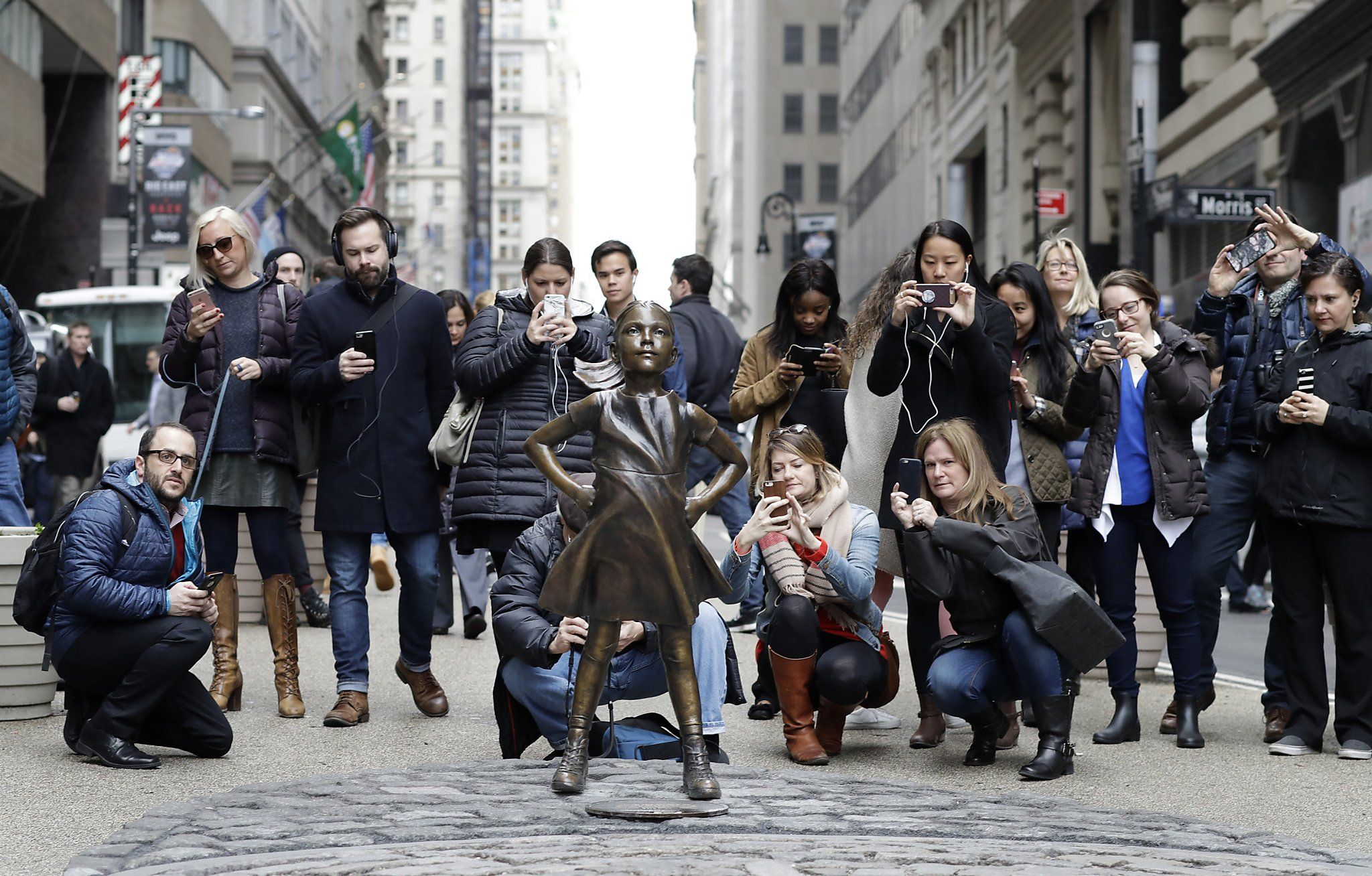 """Mayor Bill de Blasio appeared with the """"Fearless Girl"""" statue on Monday on the lower Manhattan traffic median where the two bronze figures face each other.  On Monday, Rep. Carolyn Maloney, D-N.Y., led a group of prominent women in front of City Hall to honor the artist, Kristen Visbal, and State Street Global Advisors, the asset management firm that commissioned the work.  """"She was created to bring attention to the courage and unrealized power of women in so many fields, and she has…"""