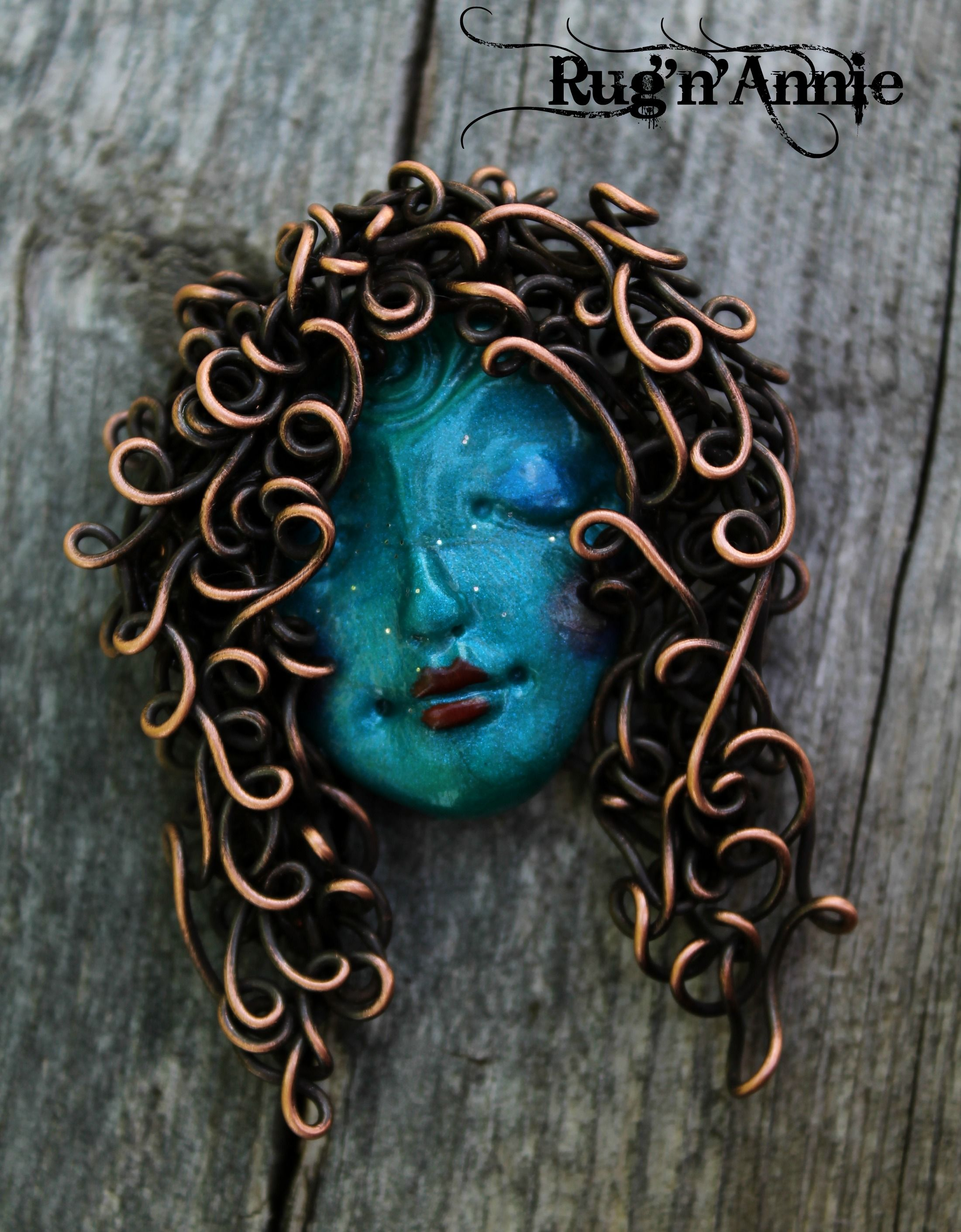 Copper wire hair and a polymer clay face...I love making these ...