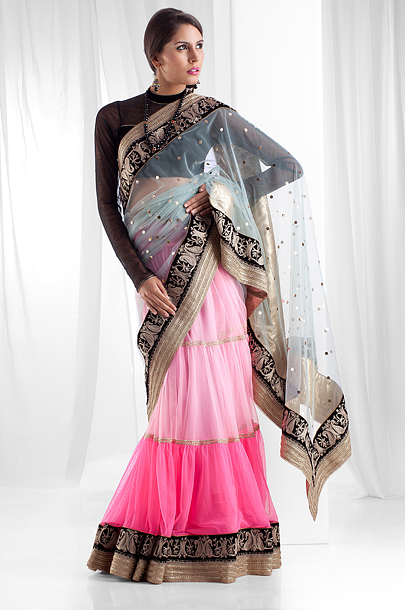 Net saree with tired skirt with attach border embellished with zari work. Blouse as seen is optional.