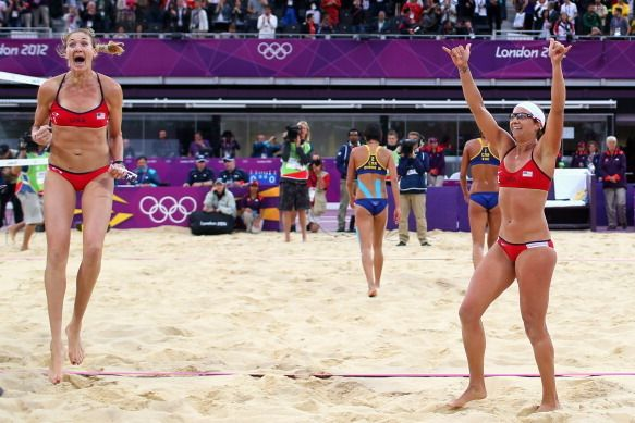 misty may treanor and kerri walsh of the usa celebrate a beach volleyball victory at