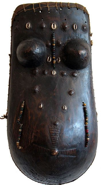 Africa | Body mask from the Makonde / Touba people of Tanzania and Mozambique | Wood, cowrie shells, glass beads.
