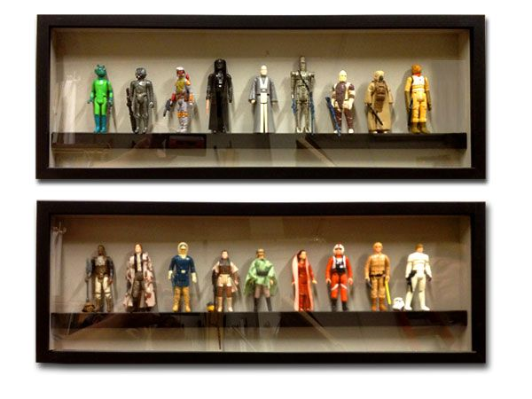 star wars collectible figures in a shadowbox frame with a shelf