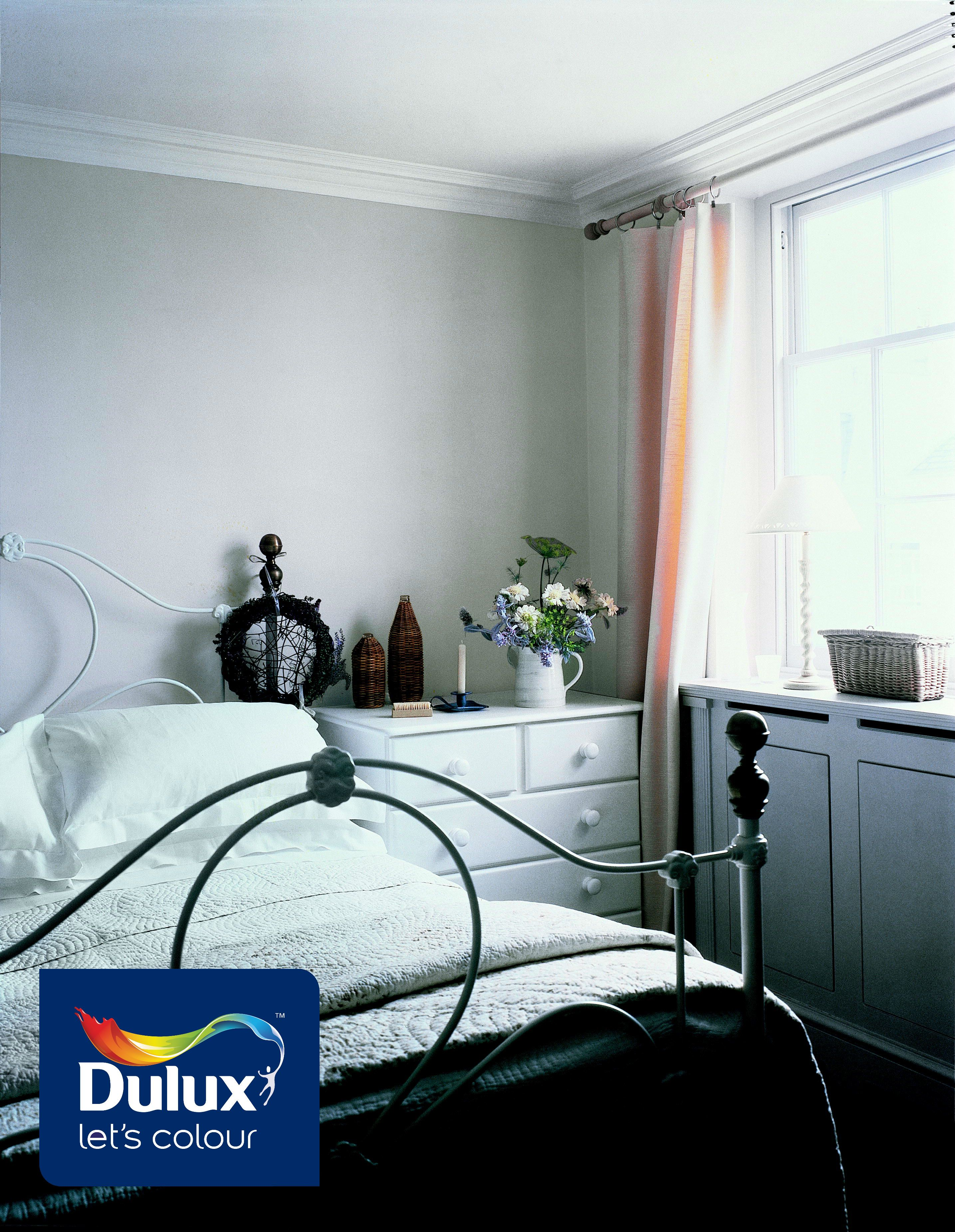 A white themed bedroom is simple yet elegant, bringing out ...
