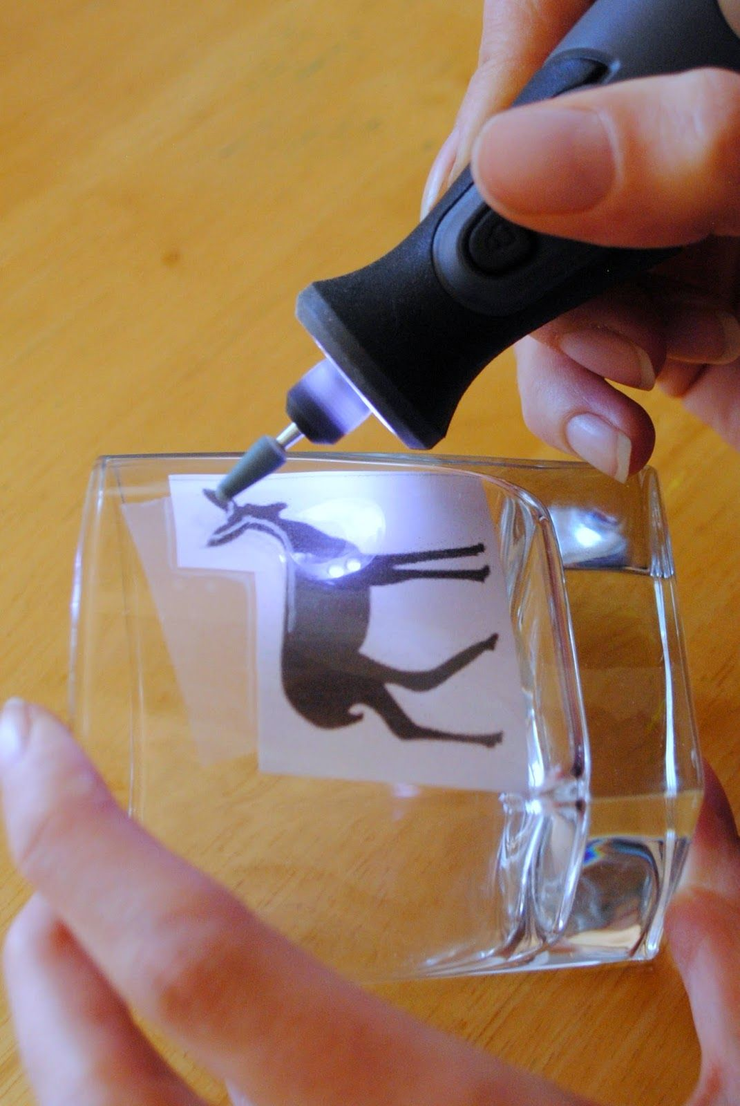Tape your design on the inside of your glass, and then