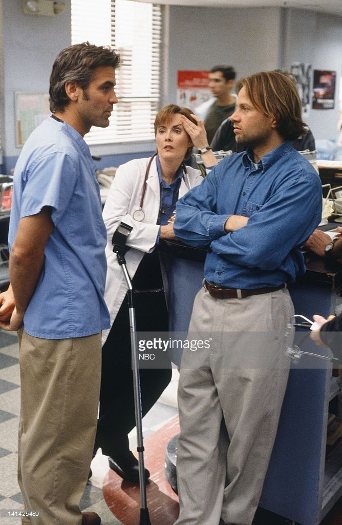 ER -- 'Suffer the Little Children' Episode 21 -- Air Date -- Pictured: (l-r) George Clooney as Doctor Doug Ross, Laura Innes as Doctor Kerry Weaver, ...