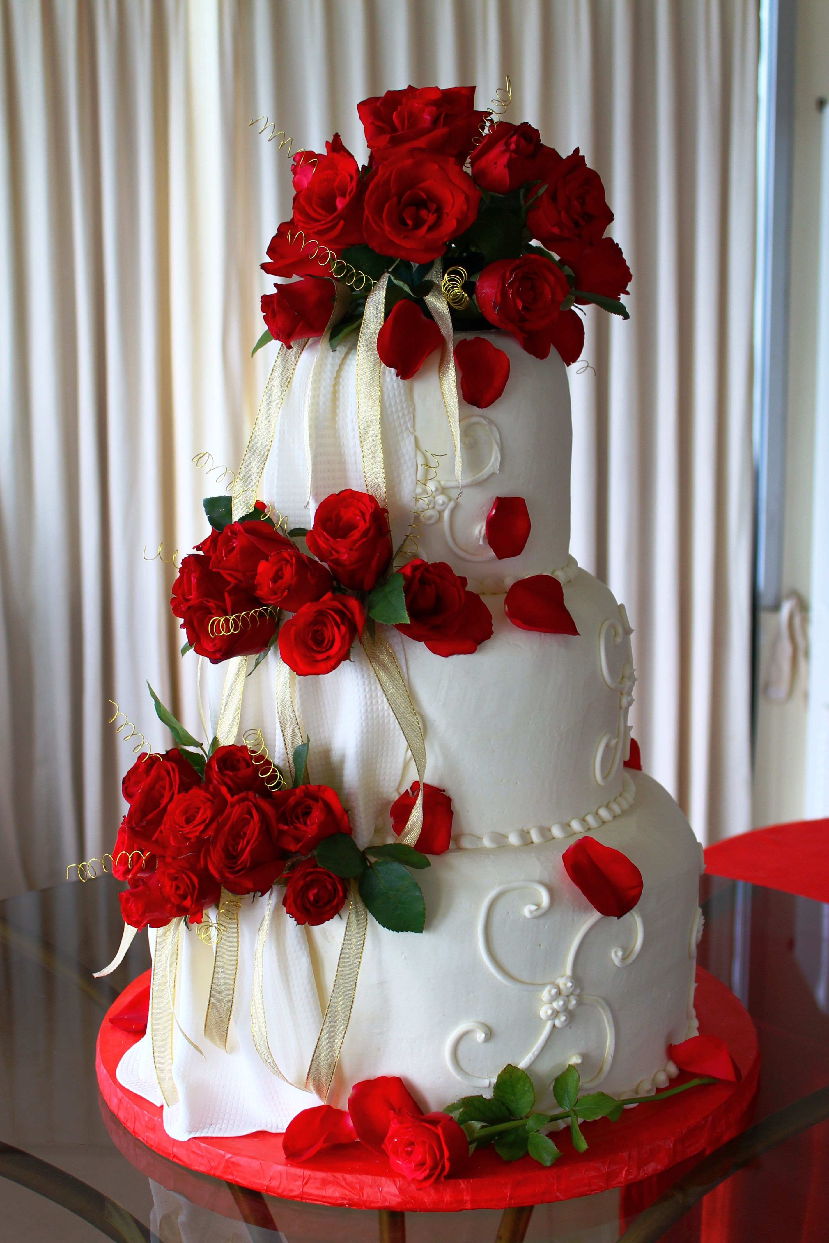 3 Layer White Wedding Cake With Piping Draping And Fresh Red Roses And Champagne Ribbons Wedding Cake Roses Wedding Cake Designs Rose Wedding