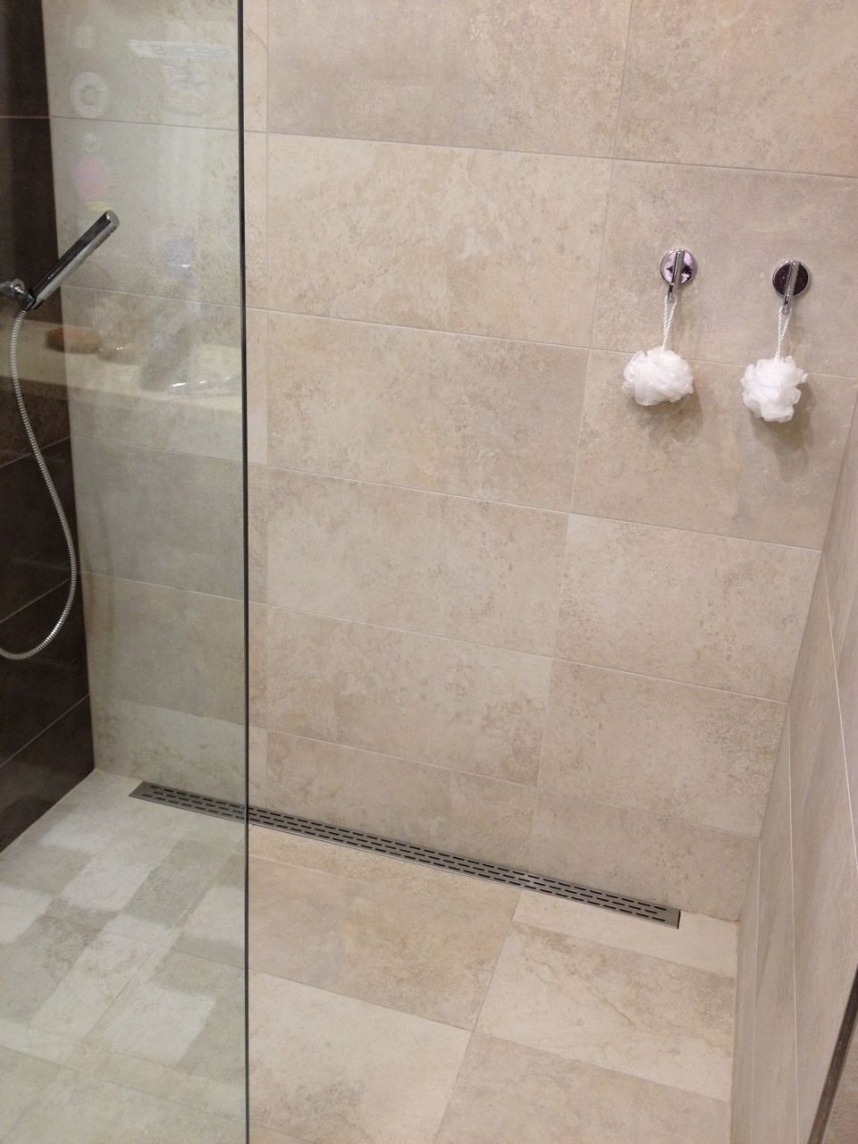 Functional, simple design. Curbless 12x24 tile shower installation ...
