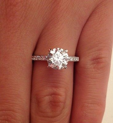 Round Diamond Engagement Ring With Small Diamond Side Stones Simple Engagement Rings Diamond Solitaire Engagement Ring Solitaire Engagement Ring