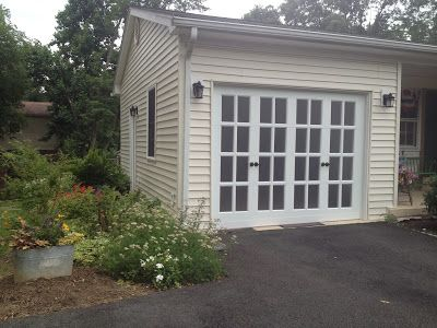 Garage Door That Looks Like French Doors And Has Lots Of Windows To Let In Light