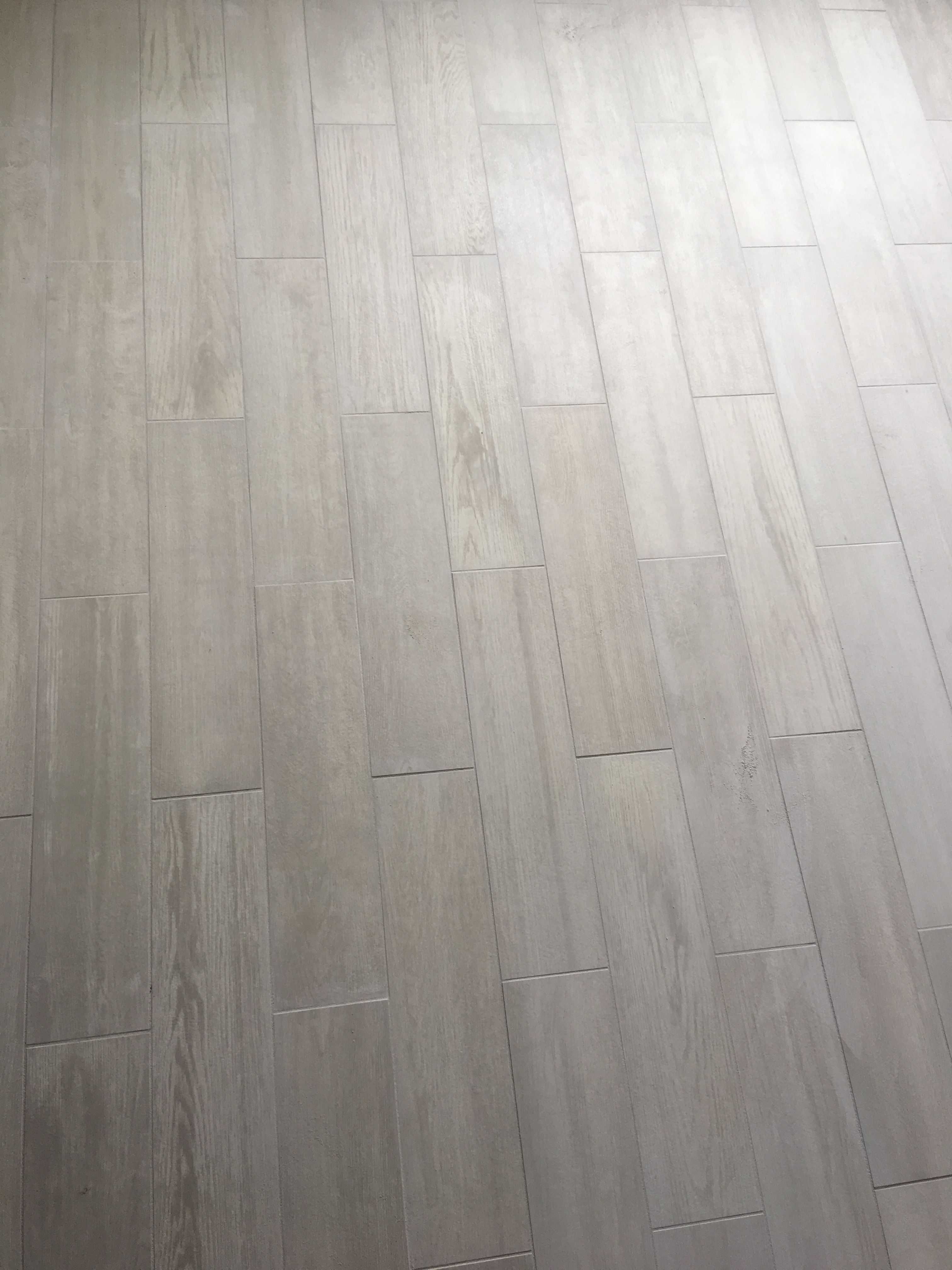 Lowe's Eldon white wood look porcelain tile with silver