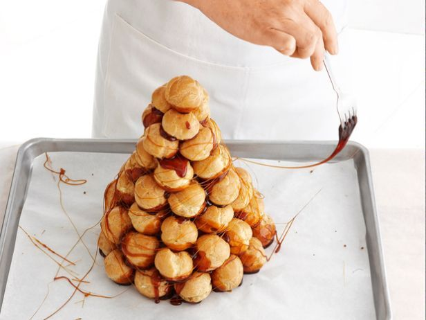 Wow your holiday crowd with a traditional croquembouche from Food Network Magazine. It's the ultimate festive dessert, and it's easier than it looks!
