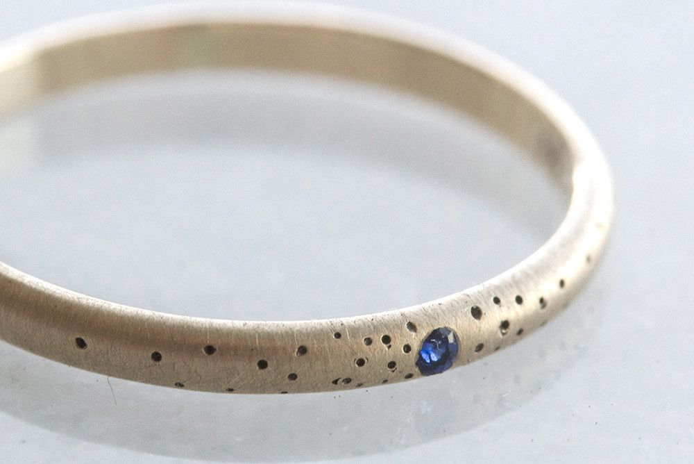 Sapphire Speckled Band | Claire's speckled band with a single sapphire set in 14k gold is like wearing a tiny piece of the night sky. Elegant, delicate and a definite heirloom piece.