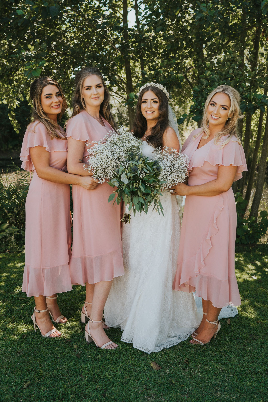 Fun portrait of bride and bridesmaids blush pink chiffon