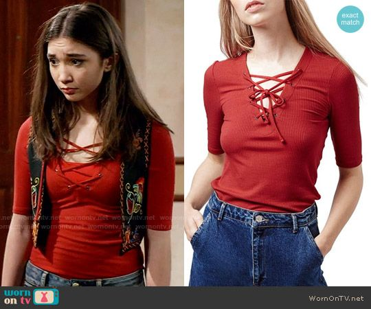 df0454a5c47 Riley s red lace-up top on Girl Meets World. Outfit Details  https
