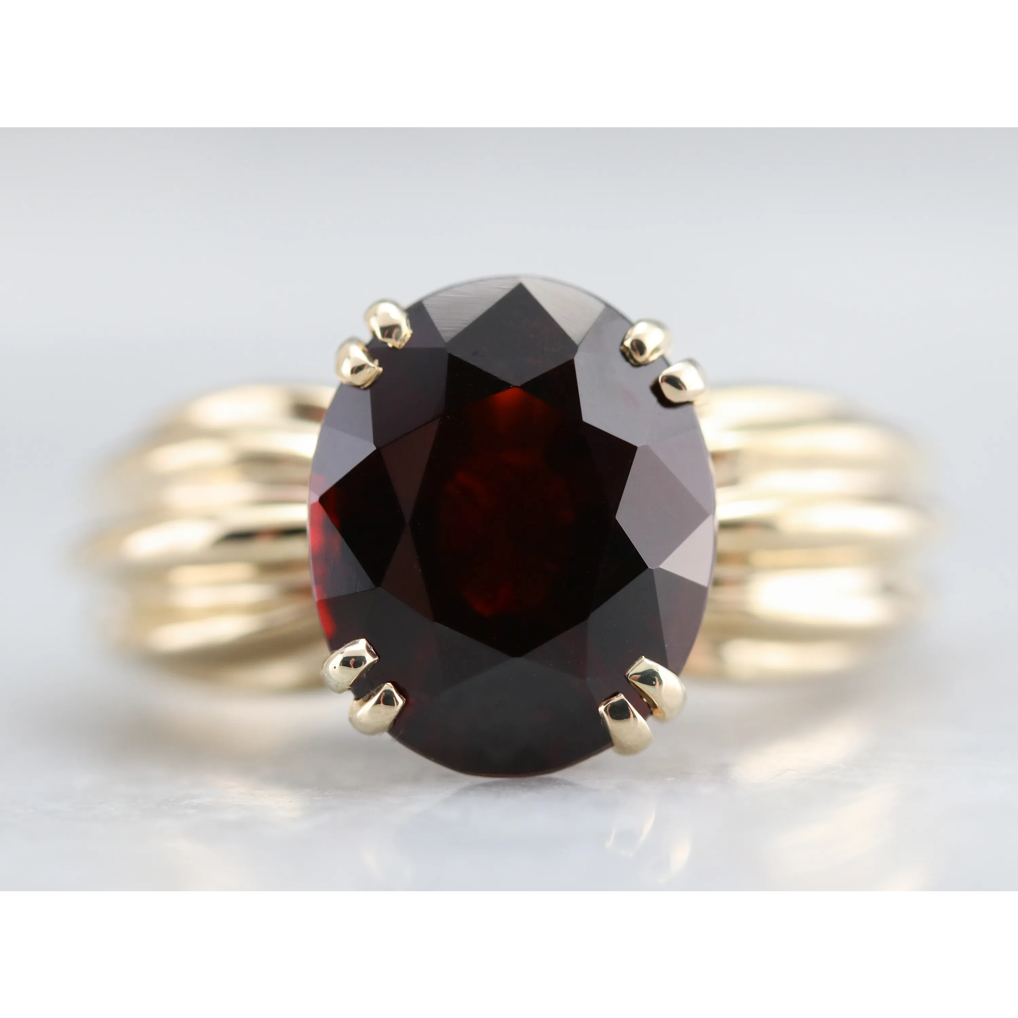 1980s Garnet Cocktail Ring is part of Cocktail rings, Vintage cocktail ring, Garnet, Vintage jewelry, Estate jewelry, Rings - Perfect in size and style, this garnet is a true cranberry red! Sparkling with winehued fire, the center stone is perfectly sized to be worn every day  Doubled prongs of polished 10 karat gold both secure the stone and give it a classical frame! Metal 10 Karat Yellow Gold Gem Garnet 4 79 Carats Gem Measurements 11 7 x 9 7 mm, Oval Ring Size 7 This item has been acid tested in our shop to assure the quality of the metal  Each item has been identified and graded by a Graduate Gemologist, we have four brick and mortar storefronts in Massachusetts, Maine, and New Hampshire and have been in business for over 25 years!