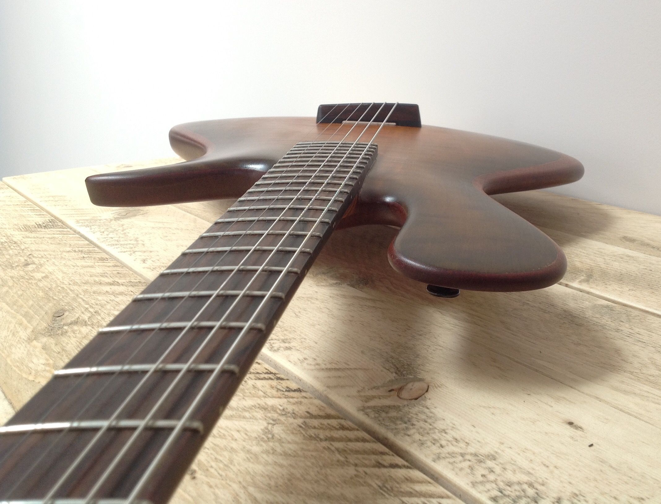 interesting this is a non electric solid body guitar no piezo pickups thin mahogany body