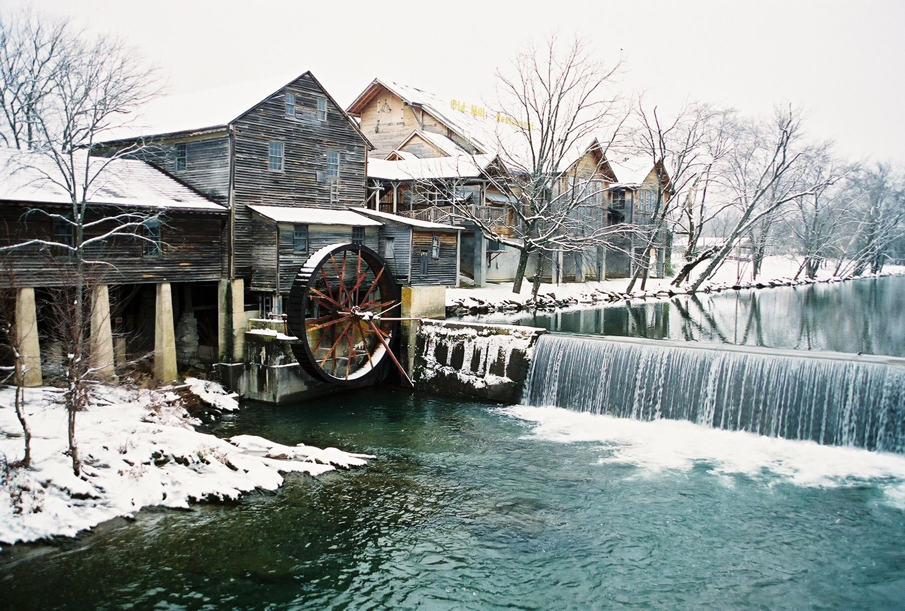 The Old Mill Covered In Winter Snow Pigeon Forge Tn