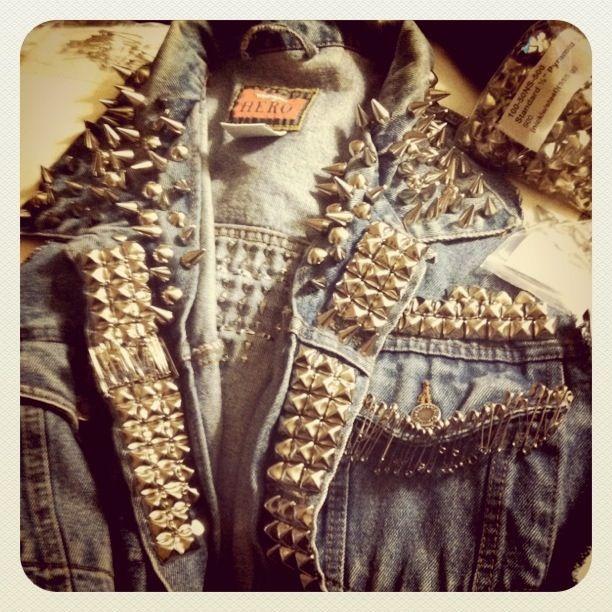 Silver pyramid studs, spikes, & safety pins on denim vest
