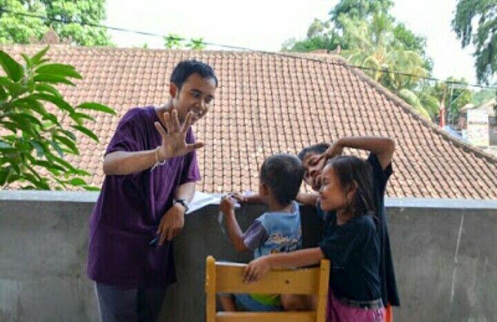 Volunteer coordinator eka translating for the kids the