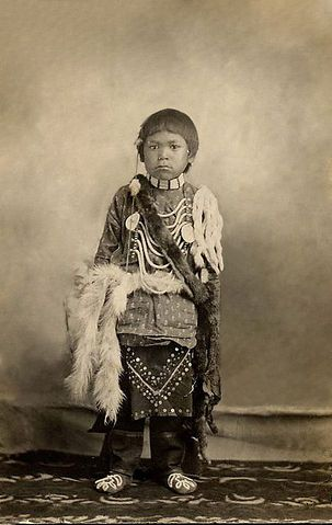 An Old Photograph Of Native American Child In Full Regalia
