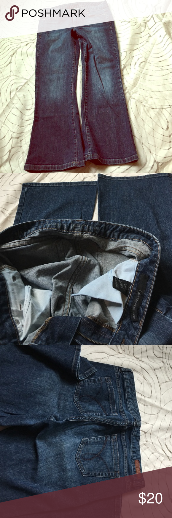 """Preloved Calvin Klein Jeans 10p Preloved Calvin Klein blue jeans.Flare.10p/30. Waist across:15 1/2"""". Crouch length:8"""". Inseam:25 1/2"""".  Ankle: 9"""" Calvin Klein Jeans Pants Boot Cut & Flare"""