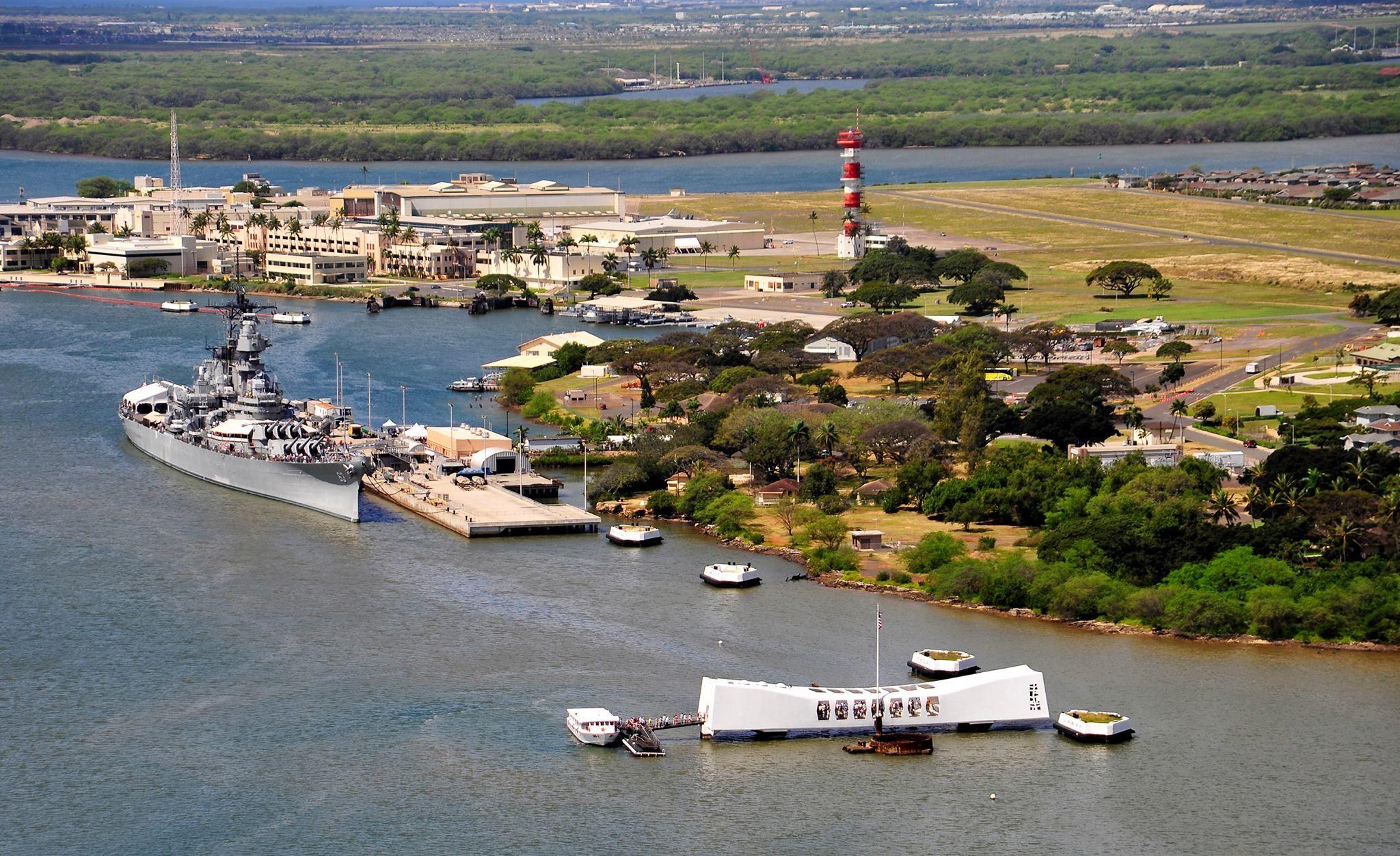 Beautiful aerial view of the USS Missouri behind the USS Arizona Memorial at Pearl Harbor.