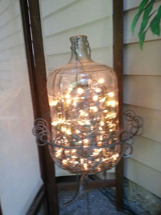One large bottle, several strands clear Xmas lights, becomes instant attractive lighting for your garden room! Beautiful in the evening.