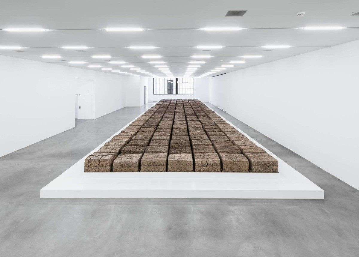 Mike Bouchet . The Zurich Load . 2016 /// Mike Bouchet reroutes and transforms the human waste of Zurich's inhabitants. In cooperation with the Werdhölzli Wastewater Treatment Plant, Bouchet has made a new form out of faeces, whose 80,000 kilos is equivalent to a day's worth of sewage production in the city.