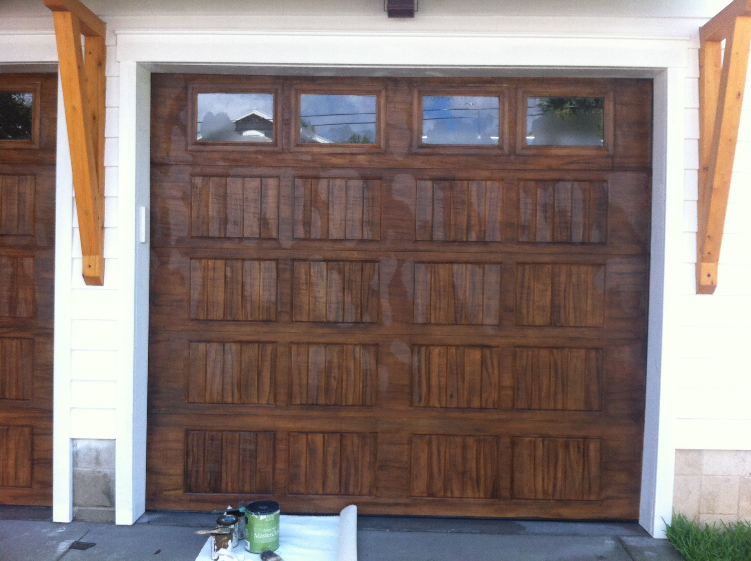 Aluminum garage doors faux painted to look like stained for Faux painted garage doors