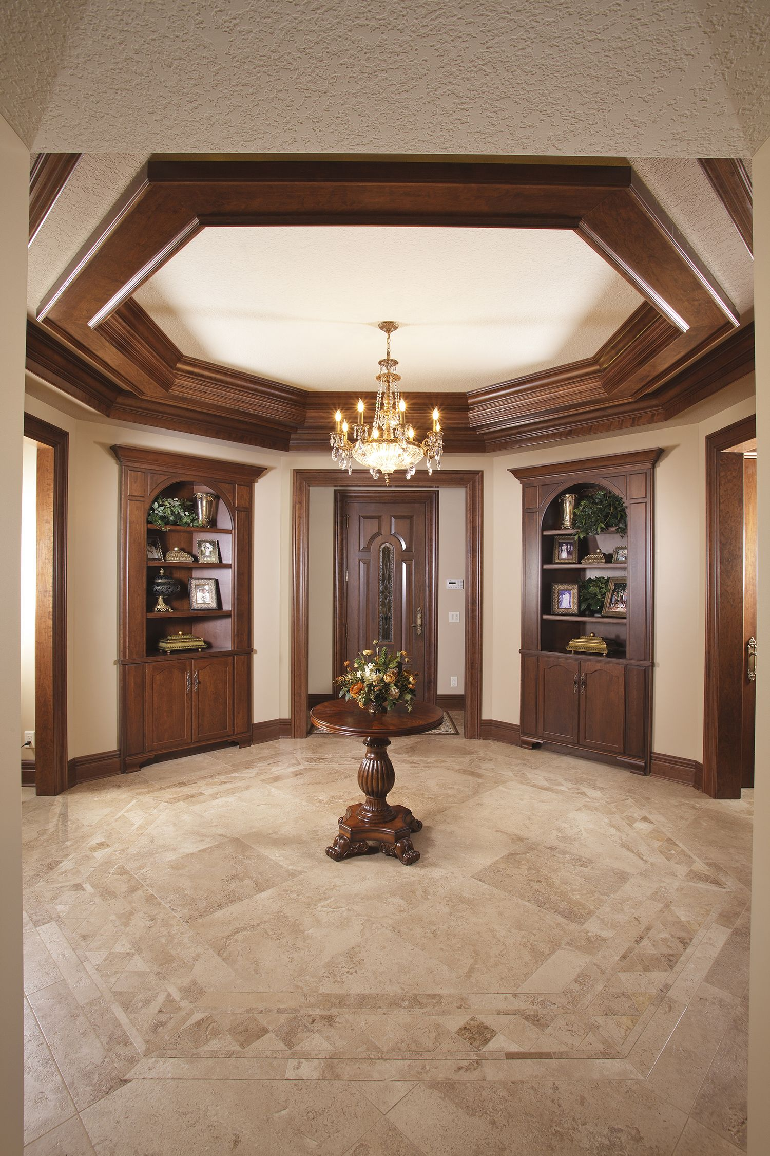 This octagonal shaped foyer consists of custom cherry crown two
