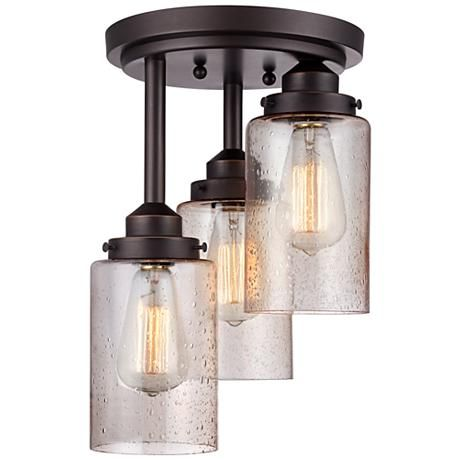 Add a nostalgic touch to your home with this oil-rubbed bronze flushmount ceiling light that included three vintage style Edison bulbs.
