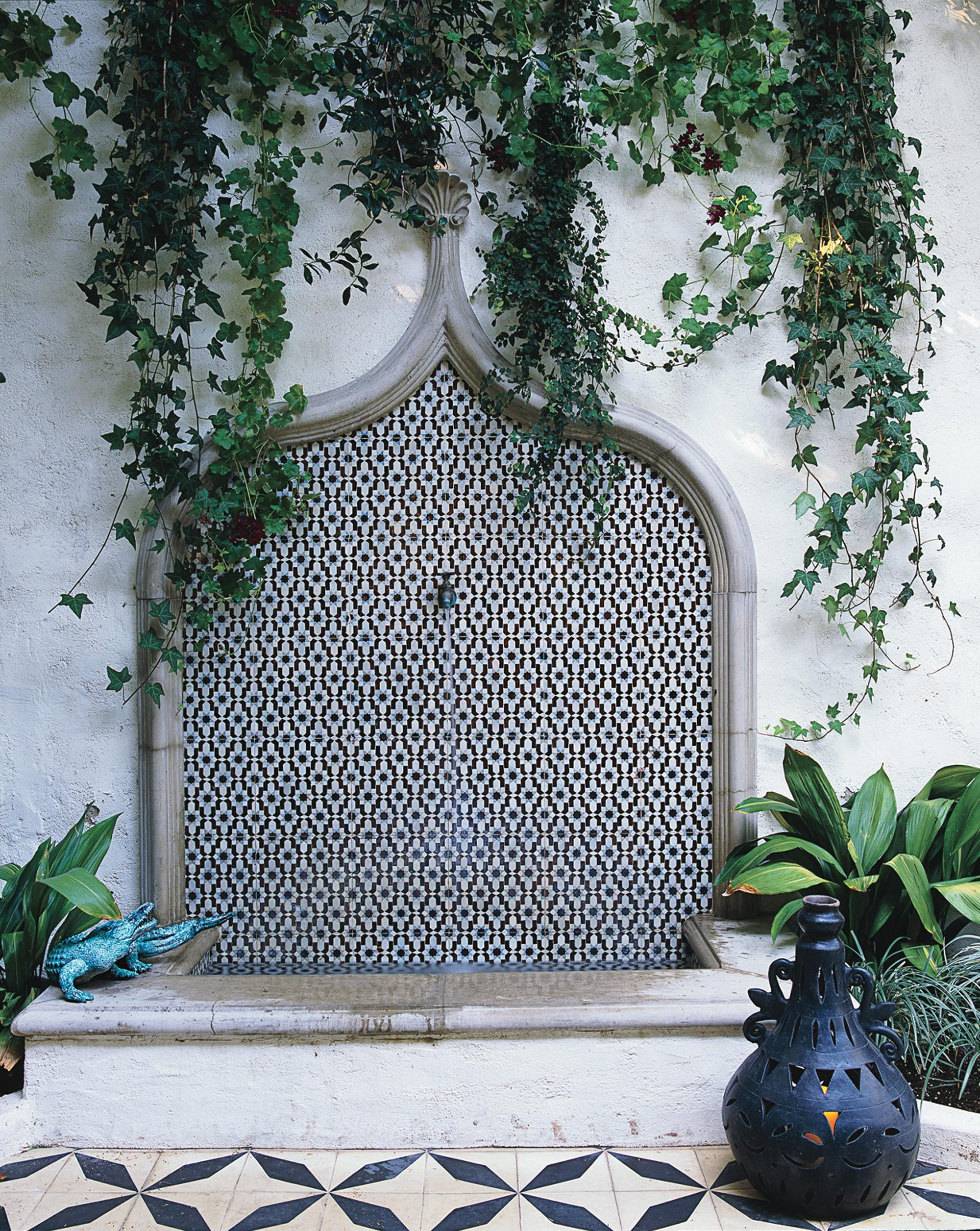 The Custom Mosaic Fountain On The Patio Features Tiles By