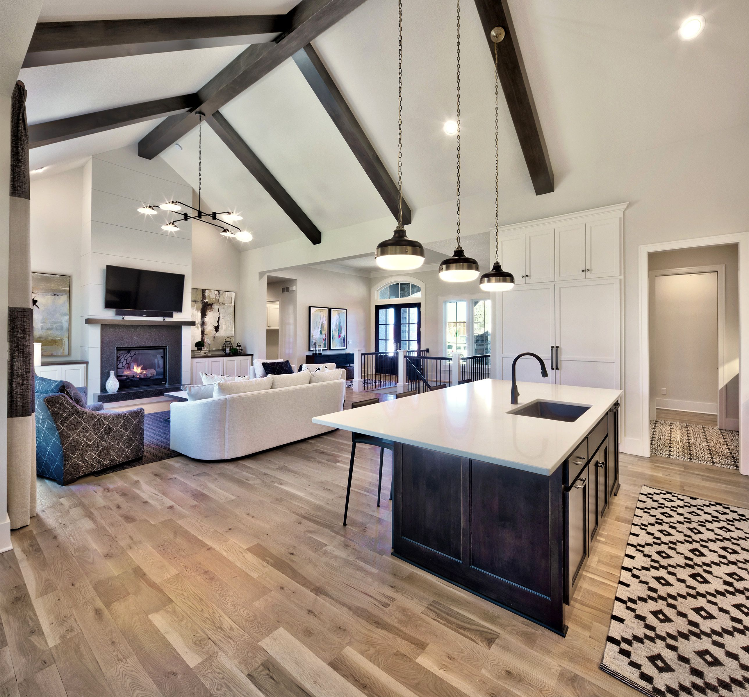 Open Concept Home Kitchen And Living Room With Tall Ceilings And