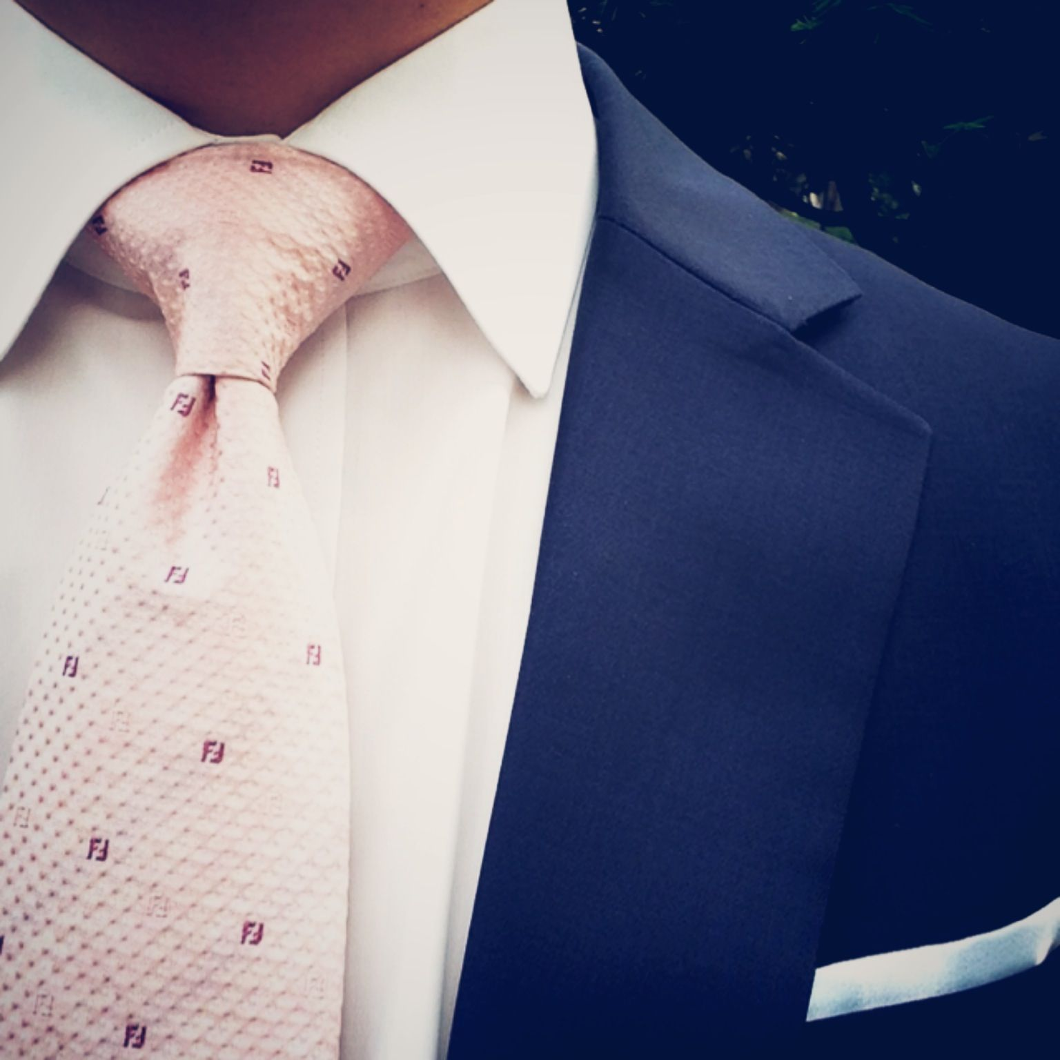 Blush Pink Tie Paired With Dark Blue Suit And White Pocket