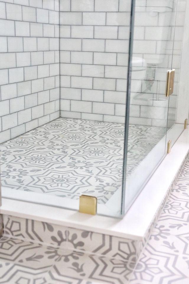 Tip Using the same tile on floors and shower pan makes the bathroom feel bigger