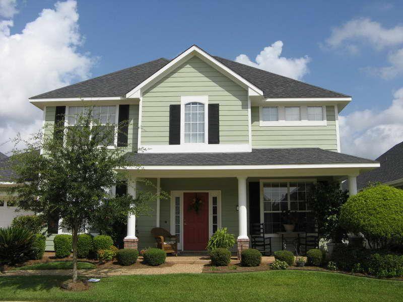 Green House, black shutters, white trim, white posts ...