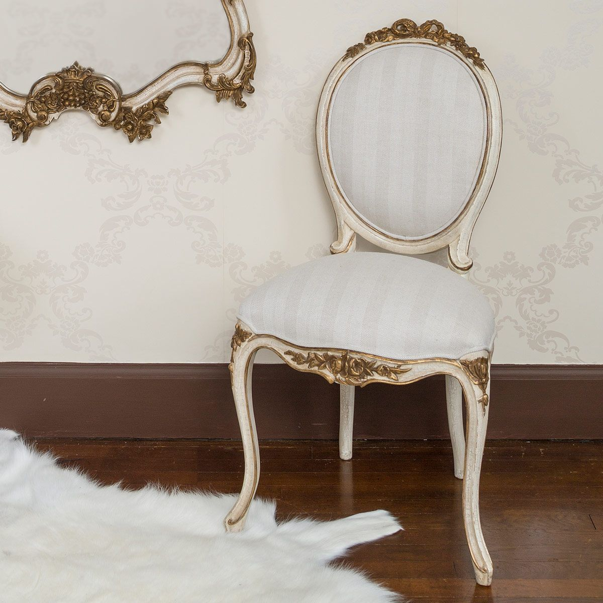 Glamorous.  French chairs, French bedroom, French furniture