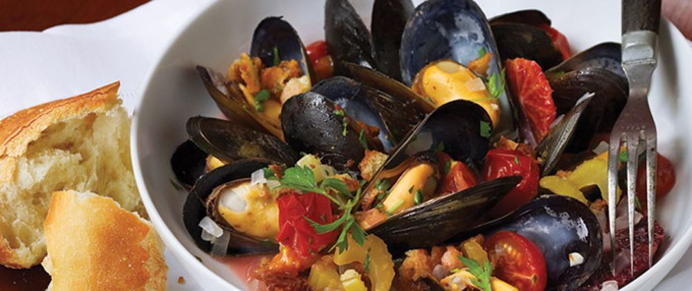 Orange Steamed Mussels with Tomatoes and Bread Crumbs Hero Image