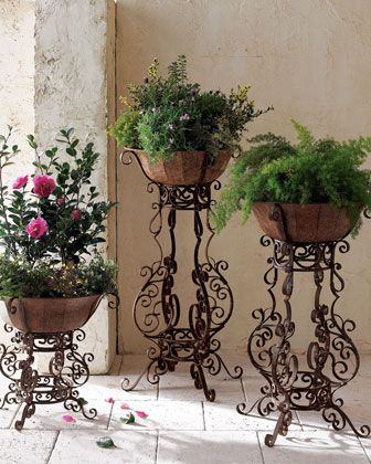 Taupe Finished Tole Pots Atop Elaborately Scrolled Iron Stands Create A Striking Display For Flowers Or Greenery