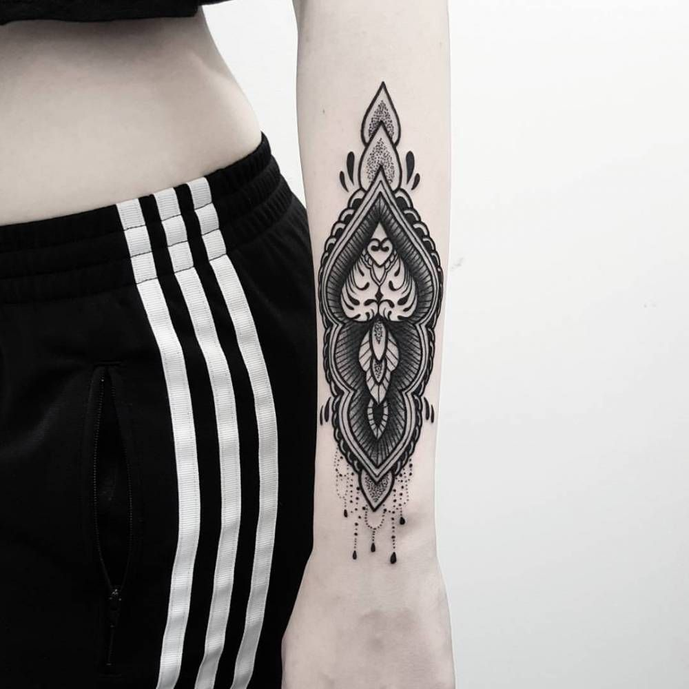 Henna inspired tattoo on the left forearm.