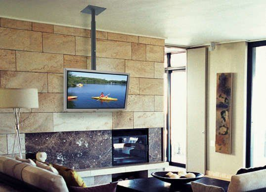 9 Smarter Spots For The Tv Tv Over Fireplace Tv Hanging From Ceiling Tv Ceiling Mount