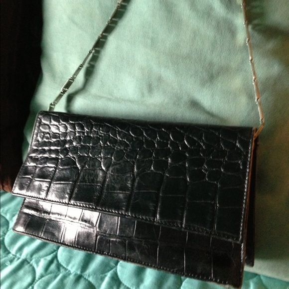 Black Aigner purse with silver chain handle. Glam up your outfit with this super chic black Aigner purse with silver chain strap. Aigner Bags Shoulder Bags