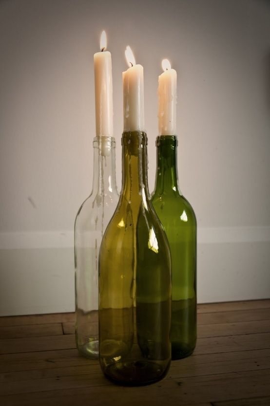 Make beautiful simple candle holders with empty wine for Champagne bottle candle holders