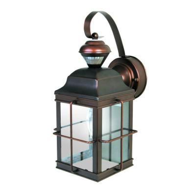 Heath Zenith New England Carriage 150 Antique Bronze Motion Sensing Outdoor Wall Lantern Sconce Hz 4144 Az The Home Depot Bronze Outdoor Lighting Motion Sensor Lights Outdoor Outdoor Wall Lantern