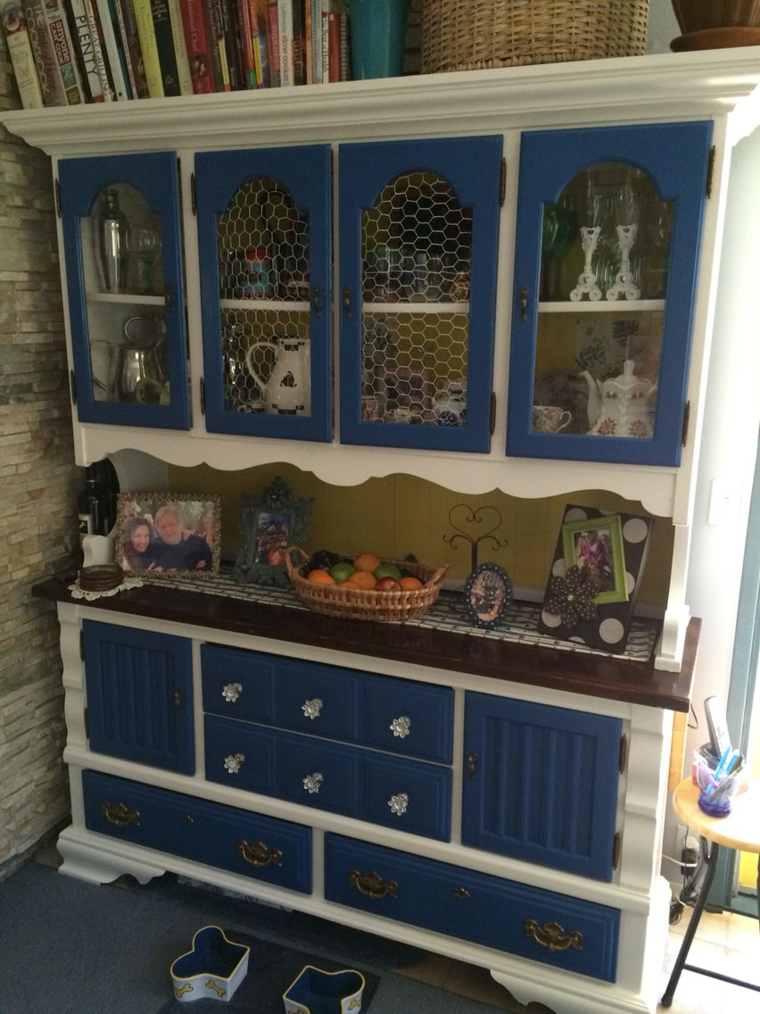 After !!!!!! New paint and nobs  Added fun chicken coop wire to the front two cabinets to replace the cracked glass