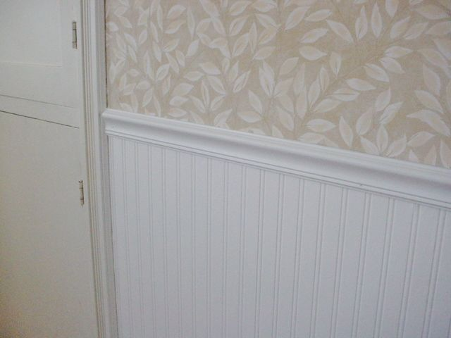 Beadboard wallpaper from Lowe's. Looks like the real thing